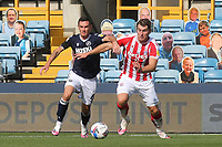 Shaun Williams of Millwall and Stoke City's Sam Vokes challenge for the ball during Millwall vs Stoke City, Sky Bet EFL Championship Football at The Den on 12th September 2020