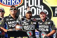 Jul. 31, 2011; Sonoma, CA, USA; NHRA top fuel dragster driver Antron Brown celebrates with his crew after winning the Fram Autolite Nationals at Infineon Raceway. Mandatory Credit: Mark J. Rebilas-