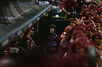 Arkansas infielder Matt Goodheart (10) waits in the dugout, Saturday, June 5, 2021 during the third inning in the second game of the NCAA Fayetteville Regional at Baum-Walker Stadium in Fayetteville. Check out nwaonline.com/210606Daily/ for today's photo gallery. <br /> (NWA Democrat-Gazette/Charlie Kaijo)