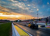 May 4, 2018; Commerce, GA, USA; The sun sets behind the car of NHRA top fuel driver Richie Crampton during qualifying for the Southern Nationals at Atlanta Dragway. Mandatory Credit: Mark J. Rebilas-USA TODAY Sports