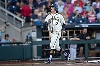 Michigan Wolverines outfielder Jesse Franklin (7) celebrates after scoring a run against the Vanderbilt Commodores during Game 1 of the NCAA College World Series Finals on June 24, 2019 at TD Ameritrade Park in Omaha, Nebraska. Michigan defeated Vanderbilt 7-4. (Andrew Woolley/Four Seam Images)