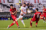 Seyed Saman Ghoddoos of Iran (C) in action against Do Duy Manh of Vietnam (L) during the AFC Asian Cup UAE 2019 Group D match between Vietnam (VIE) and I.R. Iran (IRN) at Al Nahyan Stadium on 12 January 2019 in Abu Dhabi, United Arab Emirates. Photo by Marcio Rodrigo Machado / Power Sport Images
