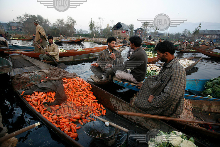 Floating vegetable market. Boat with carrots in front. Srinagar, Kashmir, India. © Fredrik Naumann/Felix Features