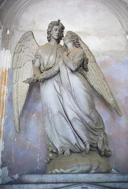 Picture and image of the stone sculpture of 2 angels by  sculptor  F Fabiani 1872. The monumental tombs of the Staglieno Monumental Cemetery, Genoa, Italy
