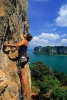 "Climber on ""Orange Juice"" 7b+ (Thaiwand Wall) Railay Beach, Thailand"