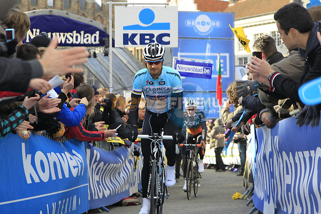 National hero Tom Boonen (BEL) Omega Pharma-Quickstep arrives at sign on before the start of the 96th edition of The Tour of Flanders 2012 in Bruges Market Square, running 256.9km from Bruges to Oudenaarde, Belgium. 1st April 2012. <br /> (Photo by Eoin Clarke/NEWSFILE).
