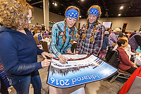 Kristy and Anna Berington sign an Iditarod poster for a fan at the 2016 Iditarod musher postion drawing banquet at the Dena'ina convention center in Anchorage, Alaska on Thursday March 3, 2016  <br /> <br /> © Jeff Schultz/SchultzPhoto.com ALL RIGHTS RESERVED<br /> DO NOT REPRODUCE WITHOUT PERMISSION
