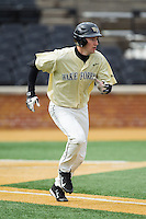 Evan Stephens (5) of the Wake Forest Demon Deacons hustles down the first base line against the Marshall Thundering Herd at Wake Forest Baseball Park on February 17, 2014 in Winston-Salem, North Carolina.  The Demon Deacons defeated the Thundering Herd 4-3.  (Brian Westerholt/Four Seam Images)