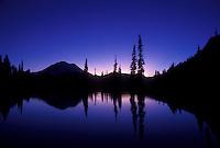 AJ3718, Mount Rainier, mirror, Mt. Rainier National Park, Cascades, Cascade Range, Washington, Silhouette of Mt. Rainier at sunset reflecting in a mountain pond at Chinook Pass in the Cascade Mountain Range in Mount Rainier Nat'l Park in the state of Washington.