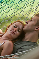 Young couple laying in hammock