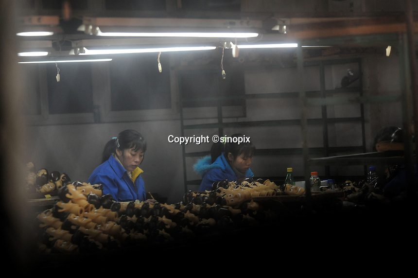 """Workers in the moulding department at Shanghai Fashion Plastics that makes the """"Woody"""" toy that features in the new Disney film Toy Story 3 that is going to be the biggest movie event of the year for children.<br /> <br /> <br /> Photos by Richard Jones/sinopix"""