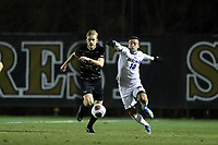 WINSTON-SALEM, NC - DECEMBER 07: David Wrona #13 of Wake Forest University and Rodney Michael #10 of the University of California Santa Barbara chase the ball during a game between UC Santa Barbara and Wake Forest at W. Dennie Spry Stadium on December 07, 2019 in Winston-Salem, North Carolina.
