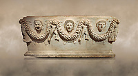 "Picture of Roman relief sculpted Sarcophagus of Garlands, 2nd century AD, Perge. This type of sarcophagus is described as a ""Pamphylia Type Sarcophagus"". It is known that these sarcophagi garlanded tombs originated in Perge and manufactured in the sculptural workshops of Perge. Antalya Archaeology Museum, Turkey.. Against a warm art background."