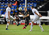 LAKE BUENA VISTA, FL - JULY 18: Bryce Duke #19 of LAFC passes the ball between two opponents during a game between Los Angeles Galaxy and Los Angeles FC at ESPN Wide World of Sports on July 18, 2020 in Lake Buena Vista, Florida.