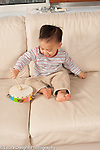 16 month old toddler boy hitting tambourine with mallet