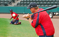 July 5, 2009: Manager Kevin Boles (19) of the Greenville Drive works with infielder Oscar Tejeda (3) in a fielding drill prior a game against the Savannah Sand Gnats at Fluor Field at the West End in Greenville, S.C. Photo by: Tom Priddy/Four Seam Images