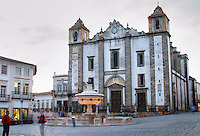 Santo Antao Church and 18th century fountain on Praca do Giraldo. Evora, Alentejo, Portugal