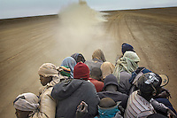 Migrants on their way through the desert towards the border with Algeria, to try to get to Europe in search of a better life.