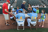 Santiago Chirino (4) and Odubel Herrera (24) of the Myrtle Beach Pelicans sign autographs before a game against the Frederick Keys on August 4, 2012, at TicketReturn.Com Field in Myrtle Beach, South Carolina. Myrtle Beach won, 4-3. (Tom Priddy/Four Seam Images)