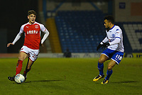 Fleetwood Town's Harrison Biggins (left) watched by Bury's Nicky Ajose (right) during the The Checkatrade Trophy match between Bury and Fleetwood Town at Gigg Lane, Bury, England on 9 January 2018. Photo by Juel Miah/PRiME Media Images.