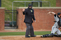 Home plate umpire Tony Carilli makes a strike call during the Big South baseball game between the Campbell Camels and the High Point Panthers at Williard Stadium on March 16, 2019 in  Winston-Salem, North Carolina. The Camels defeated the Panthers 13-8. (Brian Westerholt/Four Seam Images)