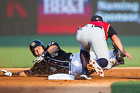 Josh Phegley (4) of the Charlotte Knights is tagged out at second base by Rob Refsnyder (13) of the Scranton/Wilkes-Barre RailRiders at BB&T Ballpark on July 17, 2014 in Charlotte, North Carolina.  The Knights defeated the RailRiders 9-5.  (Brian Westerholt/Four Seam Images)