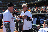 SAN FRANCISCO, CA - AUGUST 11:  Former San Francisco Giants player Mike Krukow talks with his former manager Roger Craig in front of the dugout before a ceremony honoring the 1989 Giants during a 30 year team reunion before the game between the Philadelphia Phillies and San Francisco Giants at Oracle Park on Sunday, August 11, 2019 in San Francisco, California. (Photo by Brad Mangin)