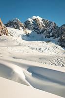 Second highest peak of Southern Alps, Mount Tasman 3497m and deep crevasses of upper part of Fox Glacier, Westland Tai Poutini National Park, West Coast, UNESCO World Heritage, New Zealand, NZ