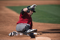 Arizona Diamondbacks designated hitter Mark Karaviotis (18) slides into third base during a Spring Training game against Meiji University at Salt River Fields at Talking Stick on March 12, 2018 in Scottsdale, Arizona. (Zachary Lucy/Four Seam Images)