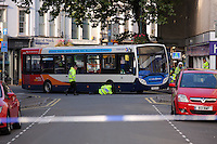 Police attending a serious RTC involving a bus and a female pedestrian on North Street in Newport, south Wales, UK. Friday 23 September 2016