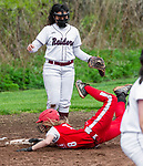 WOLCOTT, CT 051021JS30—Wolcott's Kayla Nuehlen (8) slides hard into thrd base as Torrington's Madison McLaughlin (19)  looks on during their NVL softball game Monday at Wolcott High School. Jim Shannon Republican American