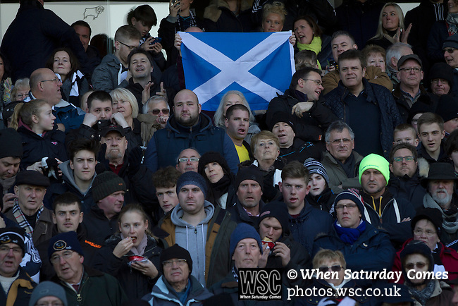 Derby County 1 Nottingham Forest 2, 17/01/2015. iPro Stadium, Championship. Home supporters with a Scottish saltire flag at the iPro Stadium before Derby Country's Championship match against Nottingham Forest. The match was won by the visitors by 2 goals to 1, watched by a derby-day crowd of 32,705. The stadium, opened in 1997, was formerly known as Pride Park. Photo by Colin McPherson.