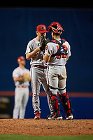 Florida Fire Frogs relief pitcher Justin Kelly (9) talks with catcher Rusber Estrada (12) during a Florida State League game against the St. Lucie Mets on April 12, 2019 at First Data Field in St. Lucie, Florida.  Florida defeated St. Lucie 10-7.  (Mike Janes/Four Seam Images)
