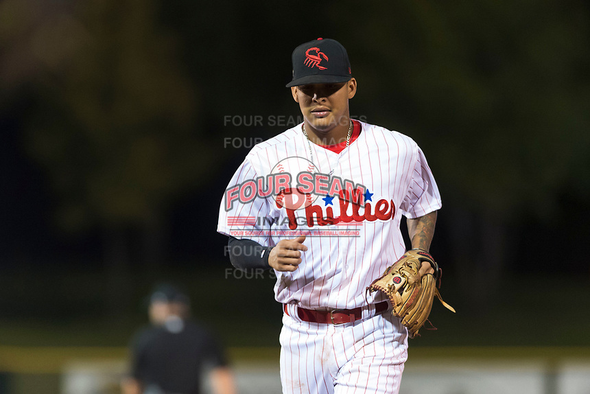 Scottsdale Scorpions shortstop Arquimedes Gamboa (7), of the Philadelphia Phillies organization, jogs off the field between innings of an Arizona Fall League game against the Surprise Saguaros at Scottsdale Stadium on October 15, 2018 in Scottsdale, Arizona. Surprise defeated Scottsdale 2-0. (Zachary Lucy/Four Seam Images)