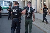 """Rechtsextreme """"Identitaere"""" versuchen Besetzung des Justizministerium.<br /> Am Freitag den 19. Mai 2017 versuchten ca. 40 Rechtsextremisten der sog. """"Identitaeren Bewegung"""" (IB) das Justizministerium zu besetzen. Sie setzten das Ministerium und den Justizminister Maas mit der Staatssicherheit der DDR gleich, hatten DDR-Fahnen dabei und trugen zum Teil DDR-Militaeruniformen.<br /> Die Neonazis scheiterten jedoch mit der Besetzung, da die Polizei im Vorfeld von der Aktion informiert war und rechtzeitig vor Ort war. Als die Polizei die Neonazis aufforderte zu gehen, legten die sich auf den Fußweg und skandierten """"Keine Gewalt"""" und Parolen gegen Fluechtlinge und fuer Deutschland. Daraufhin wurden die Neonazis einzeln abgefuehrt, durchsucht und erhielten einen Platzverweis.<br /> Im Bild: Robert Timm, Chef der Berliner """"Identitaeren"""" wird abgefuehrt.<br /> 19.5.2017, Berlin<br /> Copyright: Christian-Ditsch.de<br /> [Inhaltsveraendernde Manipulation des Fotos nur nach ausdruecklicher Genehmigung des Fotografen. Vereinbarungen ueber Abtretung von Persoenlichkeitsrechten/Model Release der abgebildeten Person/Personen liegen nicht vor. NO MODEL RELEASE! Nur fuer Redaktionelle Zwecke. Don't publish without copyright Christian-Ditsch.de, Veroeffentlichung nur mit Fotografennennung, sowie gegen Honorar, MwSt. und Beleg. Konto: I N G - D i B a, IBAN DE58500105175400192269, BIC INGDDEFFXXX, Kontakt: post@christian-ditsch.de<br /> Bei der Bearbeitung der Dateiinformationen darf die Urheberkennzeichnung in den EXIF- und  IPTC-Daten nicht entfernt werden, diese sind in digitalen Medien nach §95c UrhG rechtlich geschuetzt. Der Urhebervermerk wird gemaess §13 UrhG verlangt.]"""