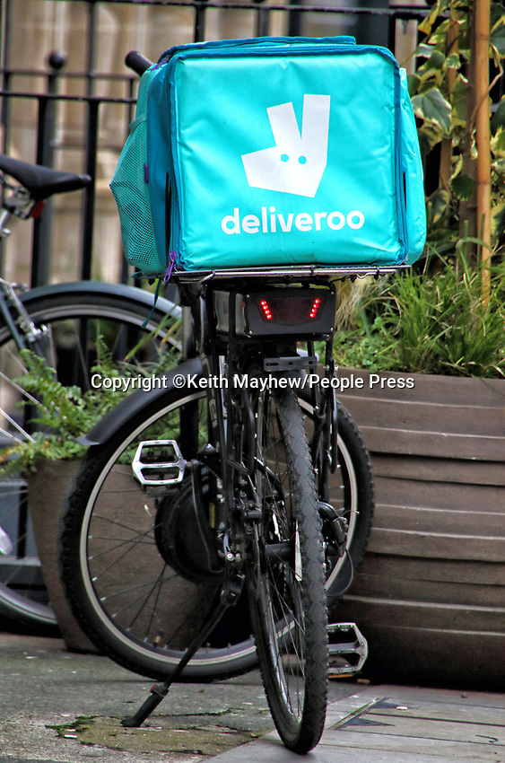 With Covid-19 lockdown causing Restaurants and Pubs all to close, many have turned to offering takeaway and delivery services. The big winners for this are the likes of the Deliveroo riders, seen almost everywhere you turn in London. London, UK on Thursday January 21st 2021<br /> <br /> Photo by Keith Mayhew
