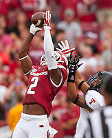 NWA Democrat-Gazette/BEN GOFF @NWABENGOFF<br /> DJ Dean, Arkansas cornerback, intercepts a pass intended for Texas Tech running back Justin Stockton in the first quarter on Saturday Sept. 19, 2015 during the game in Razorback Stadium in Fayetteville.