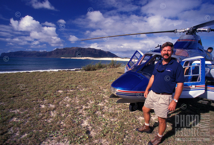 Helicopter pilot on Niihau Coastline. Pristine natural coast, white sand beaches,  reefs, and clear blue water.