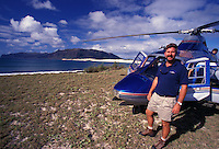 Helicopter pilot on Niihau Coastline. Pristine natural coast, white sand beaches,  reefs, and clear blue water.
