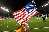 Geoff Cameron holds a flag that he grabbed from an American fan after the United States Men's National Team's won its World Cup Qualifier against Guatemala 3-1 at Livestrong Sporting Park in Kansas City, Kansas on Tue. Oct. 16, 2012.