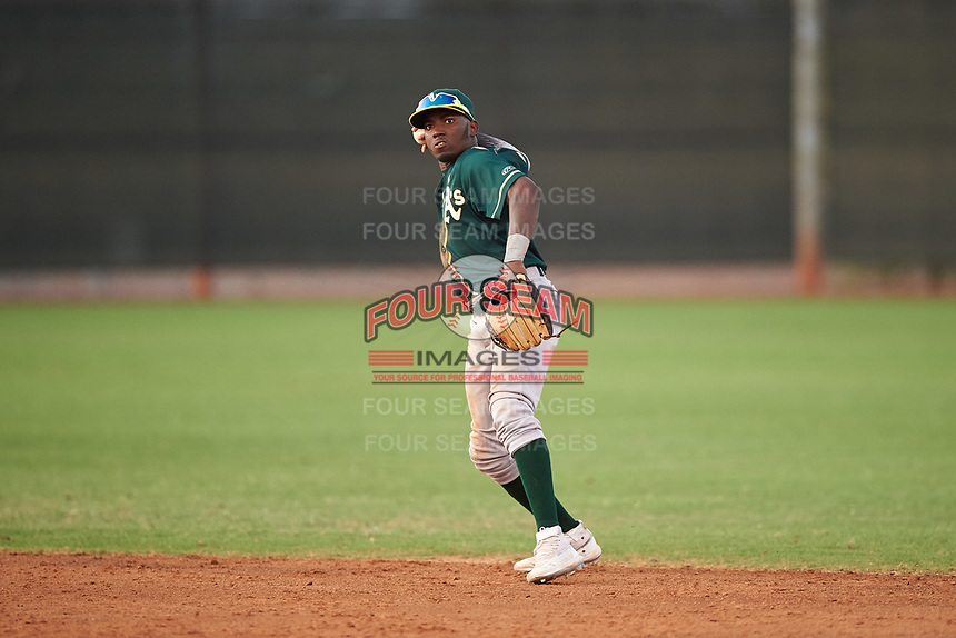 AZL Athletics Green second baseman Givaine Bisilia (1) throws to first base during an Arizona League game against the AZL Reds on July 21, 2019 at the Cincinnati Reds Spring Training Complex in Goodyear, Arizona. The AZL Reds defeated the AZL Athletics Green 8-6. (Zachary Lucy/Four Seam Images)