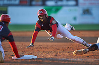 Batavia Muckdogs first baseman Javier Lopez (23) dives head first into third base during a game against the West Virginia Black Bears on June 30, 2016 at Dwyer Stadium in Batavia, New York.  Batavia defeated West Virginia 4-3.  (Mike Janes/Four Seam Images)