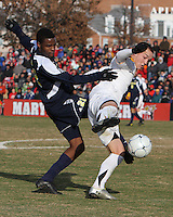 Casey Townsend #11 of the University of Maryland pulls the ball away from Latif Alashe #21 of the University of Michigan during an NCAA quarter-final match at Ludwig Field, University of Maryland, College Park, Maryland on December 4 2010.Michigan won 3-2 AET.