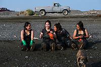 Sisters and set netters from left to right: Kayla Andrews, Selena Andrews, Karen Andrews, and Virginia Andrews, from Aleknagik, Alaska take a break on the beach in Ekuk, Alaska on the Nushagak River in Bristol Bay on July 5, 2019. (Photo by Karen Ducey)