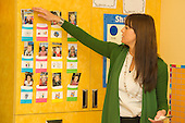MR / Schenectady, NY. Zoller Elementary School (urban public school). Kindergarten inclusion classroom. Teacher at display showing students' names and photos. MR: War15. ID: AM-gKw. © Ellen B. Senisi.