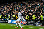 Soccer fans watch as Cristiano Ronaldo of Real Madrid celebrates his second goal during the UEFA Champions League 2017-18 Round of 16 (1st leg) match between Real Madrid vs Paris Saint Germain at Estadio Santiago Bernabeu on February 14 2018 in Madrid, Spain. Photo by Diego Souto / Power Sport Images