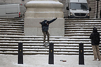 A youngster plays on his snowboard in the Snow in London as Beast from the East weather continues at City of London, London, England on 1 March 2018. Photo by Andy Rowland.