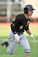 Bristol Pirates center fielder Garrett Brown (3) runs to first base during a game against the Elizabethton Twins at Joe O'Brien Field on July 30, 2016 in Elizabethton, Tennessee. The Twins defeated the Pirates 6-3. (Tony Farlow/Four Seam Images)
