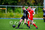 Strand Roads Paudie O'Connor and Dynamos Jonathan Burrows tussle for possession during their encounter in the Senior soccer league on Sunday