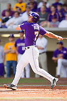 Grant Dozar #7 of the LSU Tigers follows through on his swing against the Wake Forest Demon Deacons at Alex Box Stadium on February 20, 2011 in Baton Rouge, Louisiana.  The Tigers defeated the Demon Deacons 9-1.  Photo by Brian Westerholt / Four Seam Images